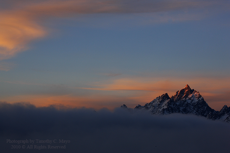 Grand Teton first light above the fog off Jackson Lake