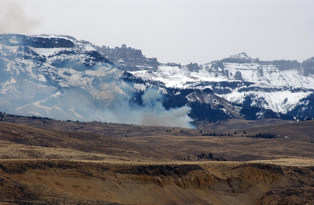 A small prescribed fire burns near the base of Carter Mountain in the Shoshone National Forest south of Cody, Wyo. (Ruffin Prevost/Yellowstone Gate file photo - click to enlarge)