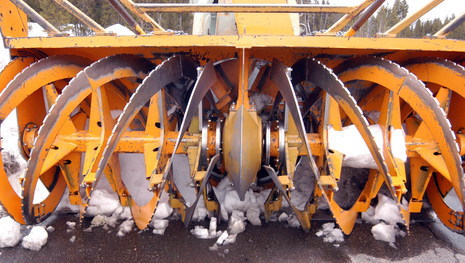 National Park Service road crews use rotary plows to clear heavy snows at the end of the winter season in Yellowstone and Grand Teton national parks. (Ruffin Prevost/Yellowstone Gate - click to enlarge)
