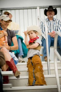 A young cowboy watches the rodeo in Wilsall, Mont. (Montana Office of Tourism - click to enlarge)