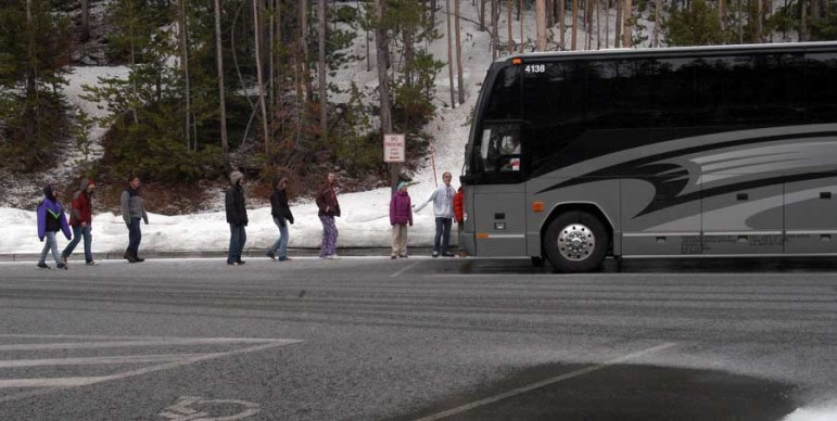 Middle school students visiting Yellowstone Park from Utah board their bus after stopping at Artist Point in this 2012 file photo.