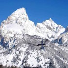 A helicopter heads toward Garnet Canyon in April 2011 during a search for two lost skiers in Grand Teton National Park. (National Park Service file photo by Jackie Skaggs - click to enlarge)