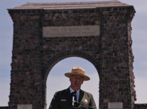 Yellowstone National Park Superintendent Dan Wenk speaks Thursday in front of the Roosevelt Arch during a kickoff event for a project that will reconfigure the North Entrance to the park. (Ruffin Prevost/Yellowstone Gate - click to enlarge)