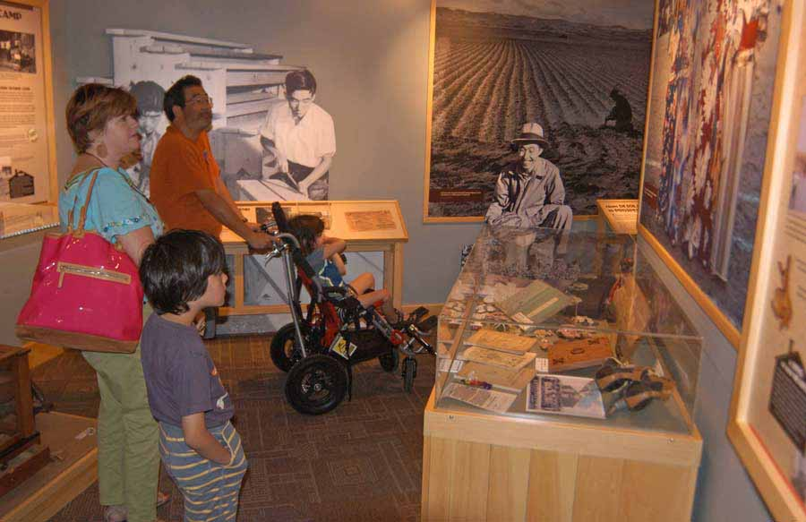 Brooke Wayne, left, Yuji Tsuno and their sons St. John, left, and Ruffin visit the Heart Mountain Interpretive Center east of Yellowstone National Park. (Ruffin Prevost/Yellowstone Gate - click to enlarge)