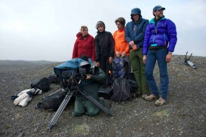"""Filmmakers form a """"human windbreak"""" for a cameraman while shooting in Alaska's Aniakchak National Monument and Preserve. (Photo courtesy of Roy W. Wood - click to enlarge)"""