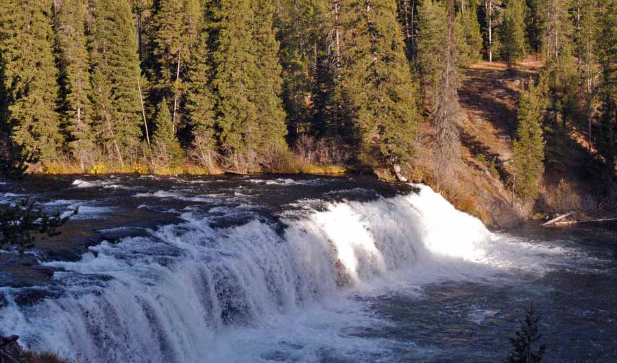 Cave Falls is 250 feet wide, making it the widest waterfall in Yellowstone National Park. It is located in the Bechler area in the southwestern corner of Yellowstone. (Ruffin Prevost/Yellowstone Gate - click to enlarge)