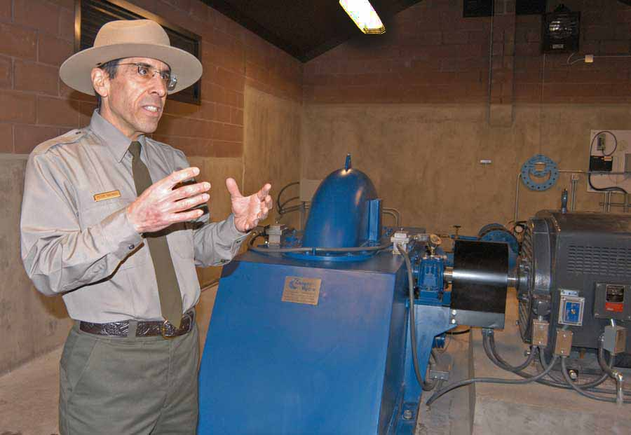 Peter Galindo, a project engineer for Yellowstone National Park, discusses a new small-scale hydro-electric power system now in use near Mammoth Hot Springs. (Ruffin Prevost/Yellowstone Gate - click to enlarge)