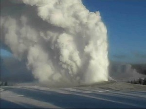 Old Faithful Geyser erupts on the morning of Dec. 19 as seen from the National Park Service webcam.