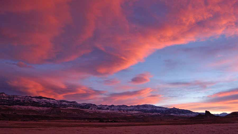 The sun sets over Carter Mountain with Castle Rock visible on the right in the South Fork Valley near Cody, Wyo. (Ruffin Prevost/Yellowstone Gate - click to enlarge)
