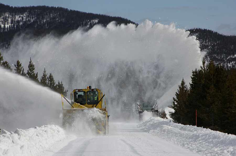 National Park Service snow plow operators clear the roads from Madison to Old Faithful. (NPS photo - click to enlarge)