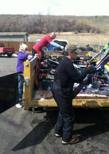 Volunteers and competitors sort through ski and snowboard gear transported to the finish line of the Grizzly Peak Adventure Race in Red Lodge, Mont. (Ruffin Prevost/Yellowstone Gate)