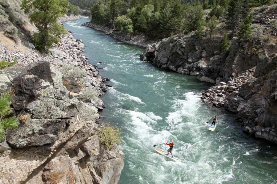 Two adventurers try their luck on stand-up paddleboards in Yankee Jim Canyon, north of Gardiner, Mont. (Montana Tourism photo)