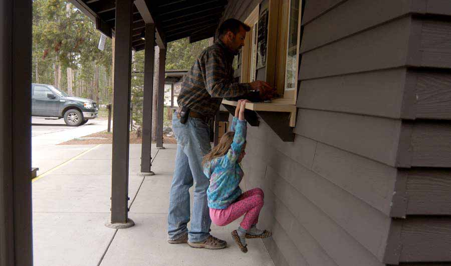 Josh and Avery Reese check into the Madison Campground in Yellowstone National Park. (Ruffin Prevost/Yellowstone Gate)