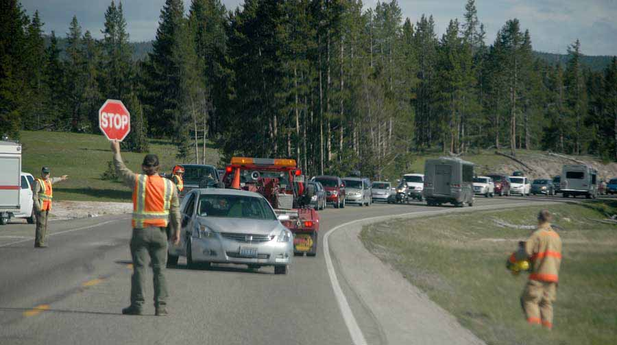 First responders work to manage traffic and assist victims in a vehicle accident near Madison in Yellowstone National Park. (Ruffin Prevost/Yellowstone Gate)