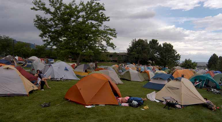Bicyclists participating in Cycle Greater Yellowstone relax at their campsite last week at the Park County Complex in Cody, Wyo.