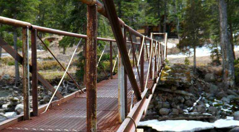 An old metal bridge crosses the North Fork of the Shoshone River east of Yellowstone National Park. Sterling Boone Cody High School