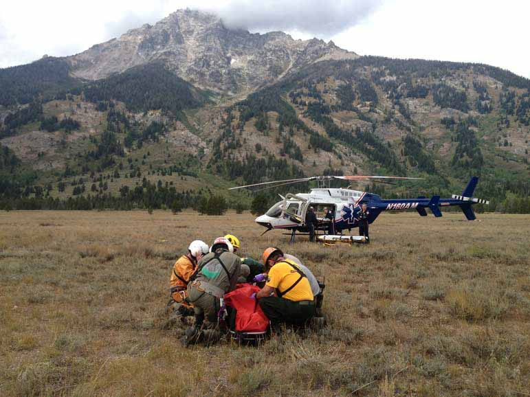 Rescue workers in Grand Teton National Park tend to climber Phil White after he was caught in a rockslide in Garnet Canyon.