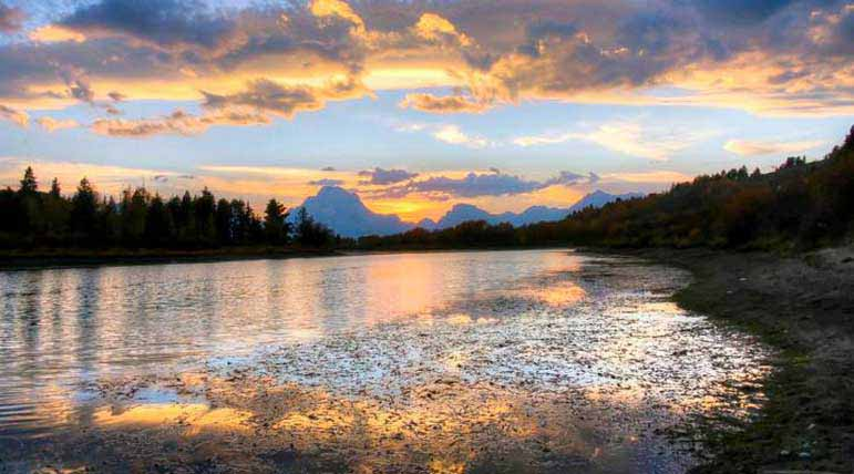 Sunlight reflects on Oxbow Bend in Grand Teton National Park. Erin Ashley Scholtz Natrona County High School