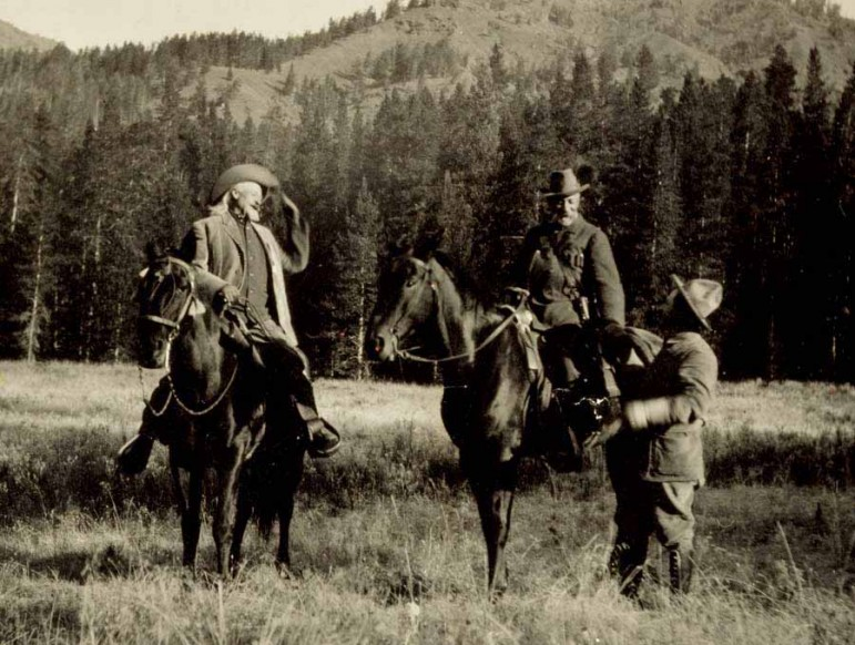 "William F. ""Buffalo Bill"" Cody (left) looks on as a man speaks with Prince Albert I of Monaco (on horseback) during the prince's 1913 hunting trip to Wyoming. (Buffalo Bill Center of the West)"