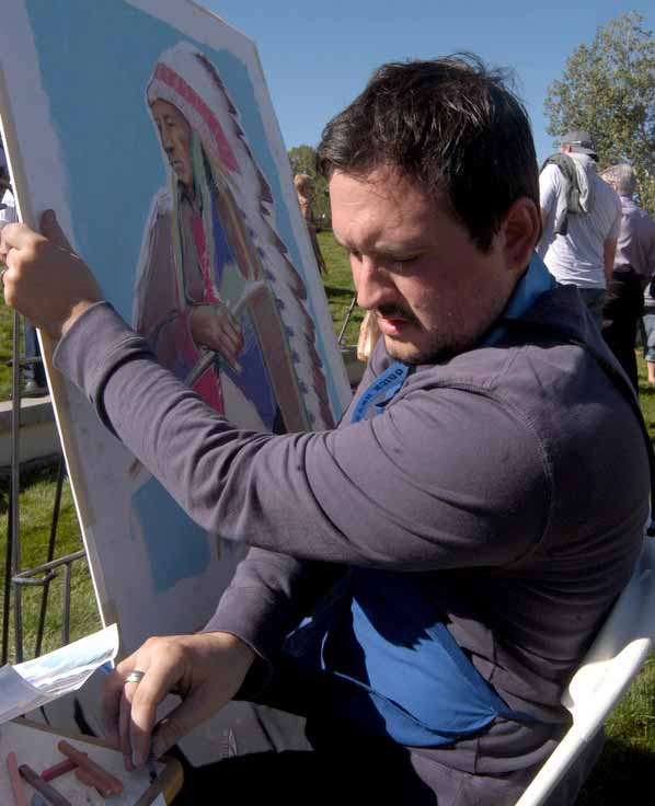 Blake Neubert creates a pastel portrait from a historical photo by Edward S. Curtis on Saturday during the Buffalo Bill Art Show Quick Draw in Cody, Wyo.