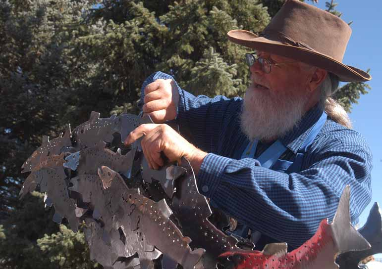 Charles Ringer assembles a sculpture Saturday during the Buffalo Bill Art Show Quick Draw in Cody, Wyo.