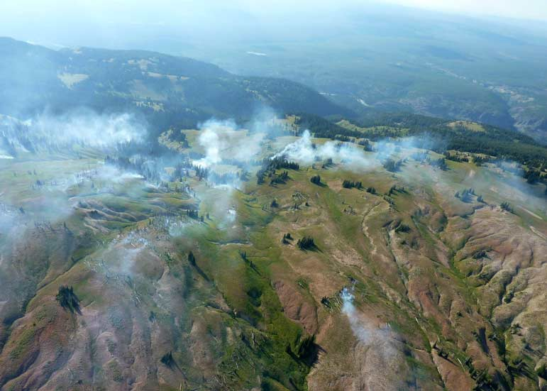 Fire danger in the Teton area has lessened after recent rain, including around the Snake Fire, which straddles the border of Yellowstone and Grand Teton national parks.