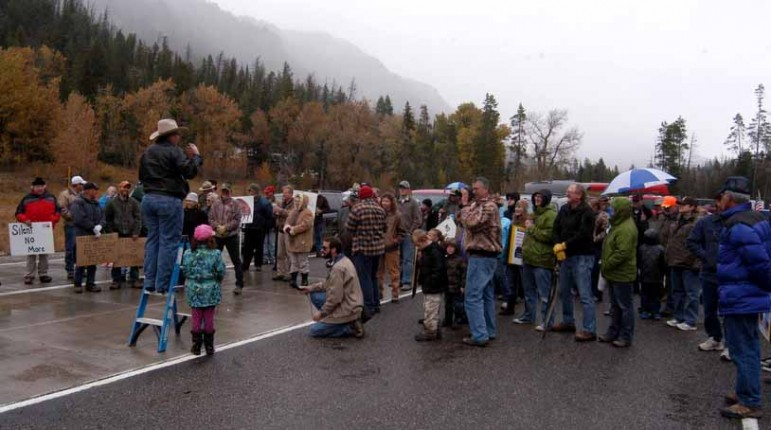 Protest organizer Rick Satterthwaite of Cody, Wyo. stands on a ladder as he speaks to a crowd of approximately 75 who gathered at the East Gate to Yellowstone National Park on Sunday to demand a solution to the federal government shutdown that has closed national parks nationwide.