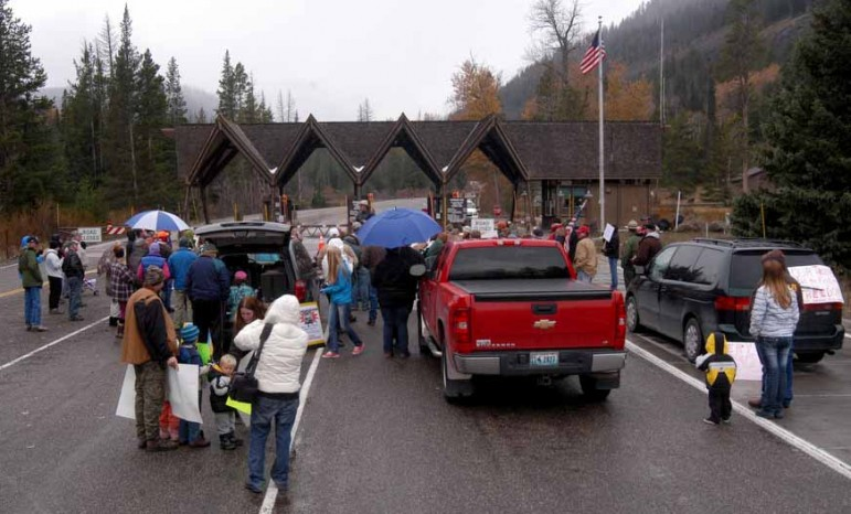 Protestors gather Sunday at the East Gate to Yellowstone National Park to demand a solution to the federal government shutdown that has closed national parks nationwide.