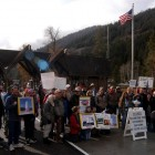 Protestors gather at the East Gate to Yellowstone National Park on Sunday to demand a solution to the federal government shutdown that has closed national parks nationwide.