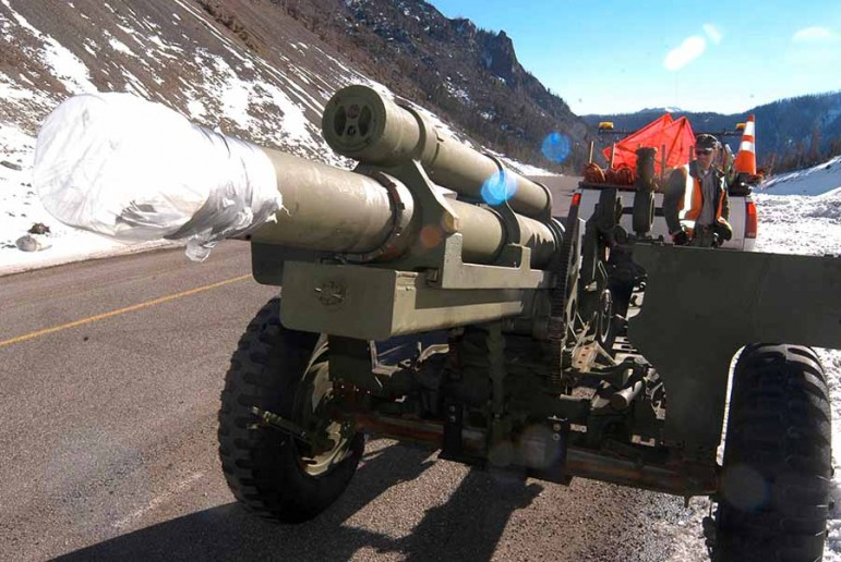 Yellowstone National Park maintenance worker Eric Holdren works last month to prepare a howitzer for use this winter in avalanche mitigation along Sylvan Pass. (Ruffin Prevost/Yellowstone Gate)