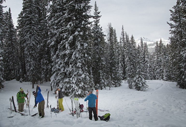Students in an avalanche prediction, survival and rescue course near Cooke City, Mont. get their gear ready.