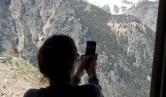 Danyel Straight-Chitwood photographs a scenic view from a bus during a 2010 trip along the Beartooth Highway.