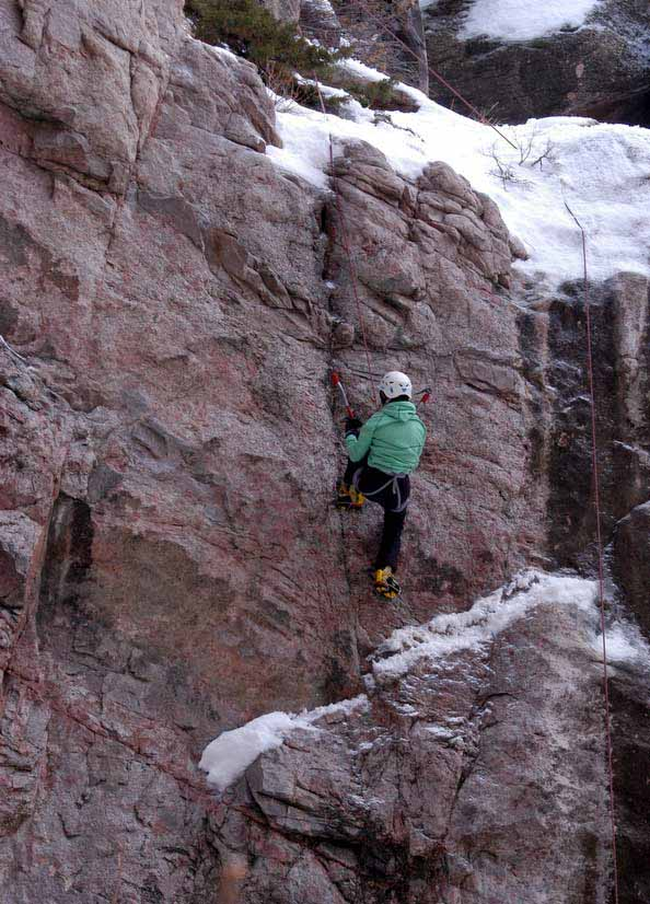A climber uses ice axes and crampons to ascend a rock face in Shoshone Canyon on Saturday during the 16th Annual Cody Ice Climbing Festival in Cody, Wyo. (Ruffin Prevost/Yellowstone Gate)