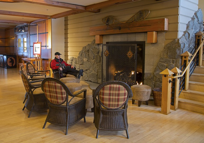The fireplace at Old Faithful Snow Lodge offers a spot where winter travelers to Yellowstone National Park can warm up.