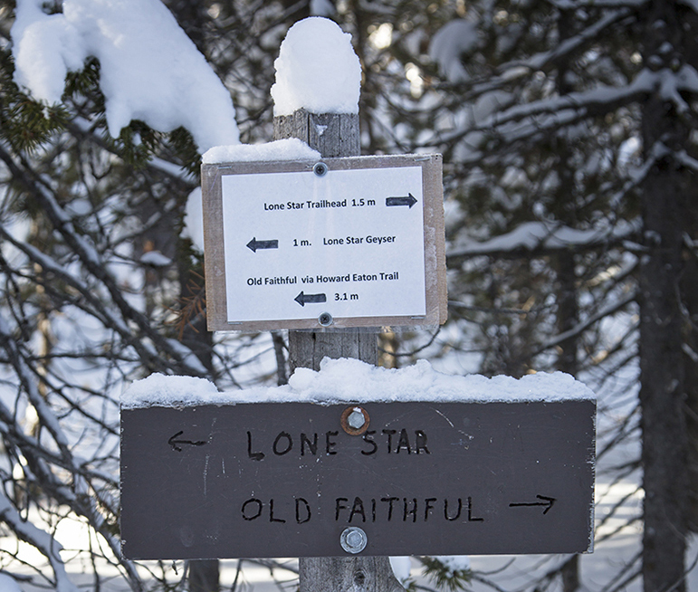 A sign points the way along a trail between Lone Star and Old Faithful geysers in Yellowstone National Park.