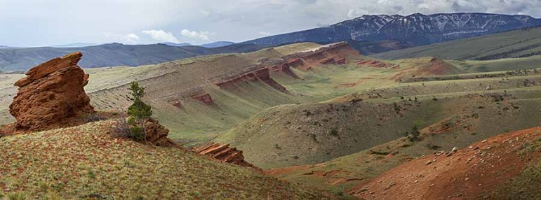 Red clay stands out in a dramatic view of the landscape as seen from the Bald Ridge trail east of Cody, Wyo. (©Kathy Lichttendahl)