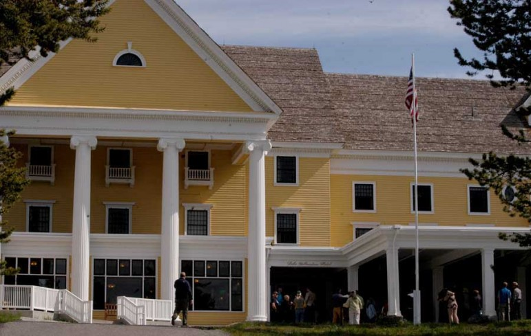 People gather Tuesday for a ribbon-cutting celebrating completion of a 2-year, $28.5 million renovation of Lake Hotel in Yellowstone National Park.