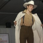 A model opens a duster from WahMaker during the Cody High Style Fashion show on Wednesday in Cody, Wyo.