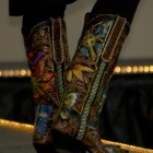 A model shows off a pair of boots designed by Scott Wayne Emmerich of Tres Outlaws during the Cody High Style Fashion show on Wednesday in Cody, Wyo.