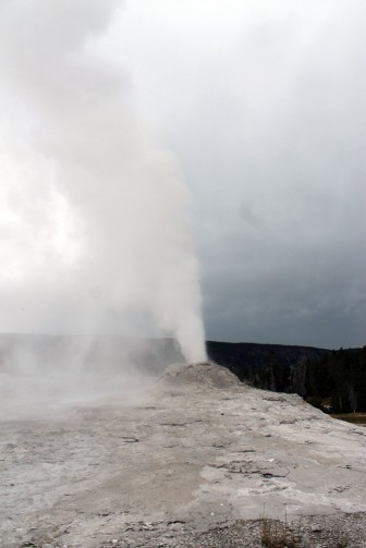 Lion Geyser erupts in Yellowstone National Park.