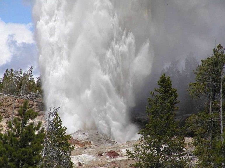 Steamboat Geyser erupts in Yellowstone National Park in 2005. The Norris Geyser Basin feature is the largest active geyser in the world, spewing water more than 300 feet into the air during full eruptions.
