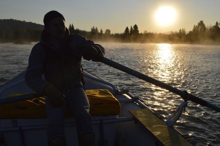 The sun rises over the Snake River in Grand Teton National Park.