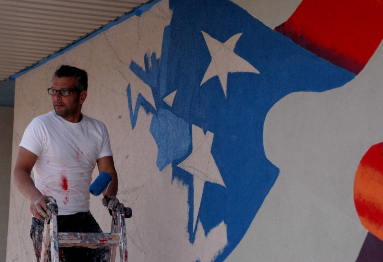 Artist Scott LaBaido is painting American flag murals on veterans' posts in all 50 states, including one in Cody, Wyo.