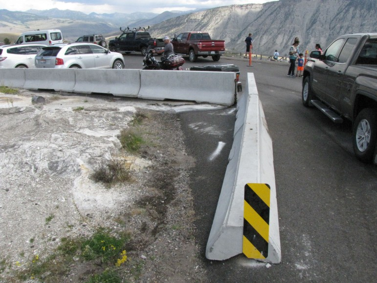Temporary concrete barriers have been installed around a newly formed thermal feature at the Upper Terrace Drive in Yellowstone National Park.
