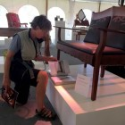 Western design enthusiast Peggy Ruble examines, Teton Settee, created by John Gallis of Norseman Designs West.
