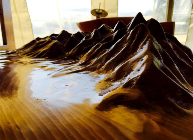 A detail from a side table by Chip Miller of DeKantie Studios and Design depicts the Teton Range, as viewed from Willow Flats in Grand Teton National Park.