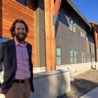 Dylan Hoffman, director of environmental affairs in Yellowstone for Xanterra Parks and Resorts, stands near the entrance to Paintbrush Lodge, a newly completed employee dormitory in Yellowstone National Park.