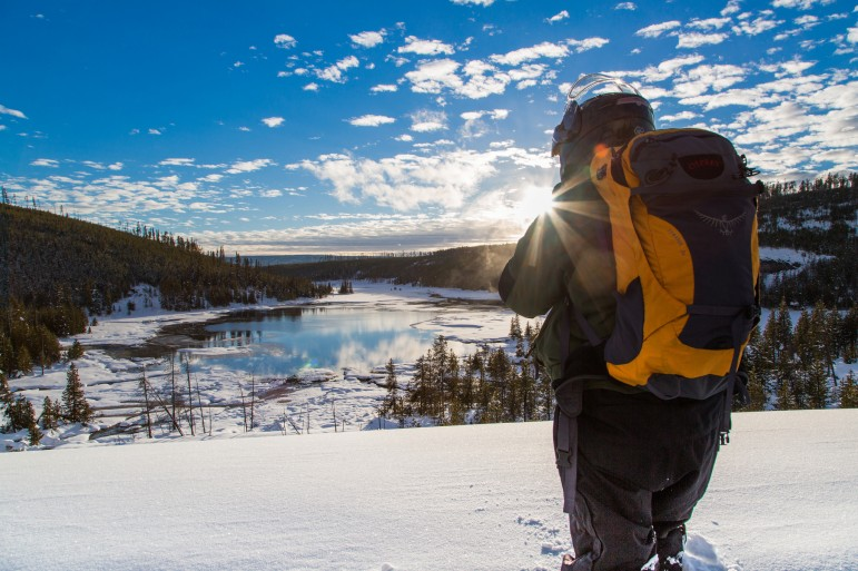 A visitor to Yellowstone National Park stops to take in the snowy view.