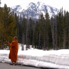 A Buddhist monk from Thailand takes photographs at Sylvan Lake on Friday in Yellowstone National Park.